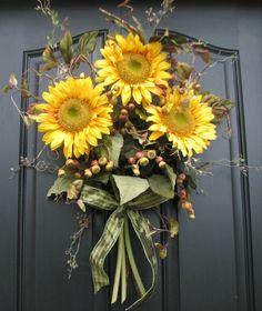 sunflower wreath, love it against the black door