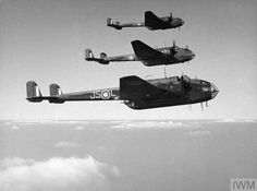 Handley Page Hampdens of No. 16 OTU (Operational Training Unit) in flight. Aircraft P5304 JS-L in foreground.