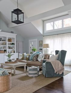 coastal living with a modern feel, love the jute rug, baskets, black pendant lantern, blue slip-covered wing char and white painted coffee table x