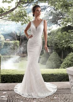 mon cheri bridals Y21742 Aquarius - Allover lace V-neck fit and flare wedding dress. Sleeveless guipure lace over soft satin lightweight fit and flare gown with deep V-neckline, illusion lace V-back features zipper trimmed with diamante buttons, court length train.