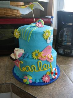 A festive pool party themed cake for a swimming party.  This one was fun to do!
