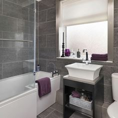 Grey bathroom with a touch of purple