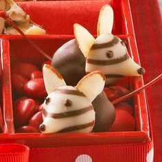 35 Heavenly Homemade Food Gifts | Midwest Living~T~ These little mice are so easy to make. Cherries dipped in chocolate with kiss heads and almond ears, nestled in a bed of red M&Ms. Too cute.