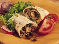 Black beans, mushrooms, spinach leaves and Cheddar cheese find themselves tasty and nutrient-rich partners in this quick wrap sandwich.
