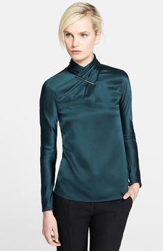 LOVE this shirt.  The fit is just right, and the neckline is unique.  The long sleeves work on this one.