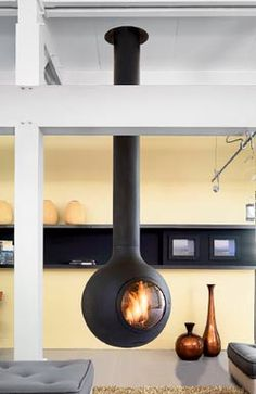 Hanging fireplace design and construction, including modern suspended designs are available through Focus and CFD. Suspended Fireplace, Hanging Fireplace, Custom Fireplace, Fireplace Design, Modern Fireplace, Focus Fireplaces, Contemporary Decor, Contemporary Fireplaces, Hearth