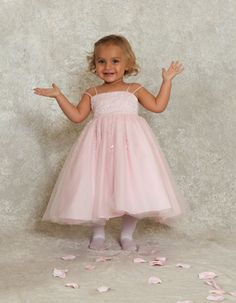 Baby Flower Girl Dress style i383t by Sweetie Pie Collection has a satin princess bodice with tulle overlay, scattered sequins and beads.  It has an extra full tulle skirt adorned with clear sequins and glass beading in a swirl pattern. www.SweetiePieCollection.com