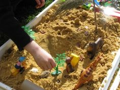 You will need sand, sand…… glorious sand! A box filled with bits and pieces, toy animals, recycled items such as toilet rolls, empty bottles and boxes......Pretend cars traveling though toilet roll tunnels, a frog sitting in a pond and a little doll sun baking on a dried leaf.