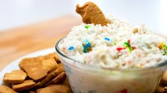 If you clicked on this video, we know you love the 90s. So do we! That's why we decided to show you how to make our favorite childhood snack. Dunakroos! Ingredients: 1 Box Funfetti 1 C. Cool Whip 2 C. Plain Yogurt Animal Crackers Add your funfeetti mix, yogurt, and cool whip to a mixing bowl and whisk together. Let cool in a refrigerator for 4 hours then enjoy!