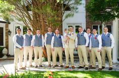 Groomsmen with blue vests and khaki pants.
