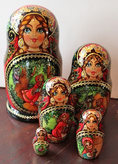 "Hand-painted Russian ""Little Red Riding Hood"" stacking dolls"