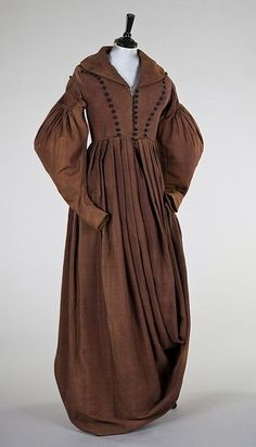brown wool `Amazone' or riding habit, circa 1835-8, the one-piece gown with triple row of satin covered buttons to the bodice, broad collar, the sleeves with pleated mancherons, elongated skirt for riding side-saddle, lined in brown cotton