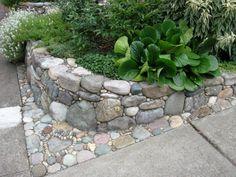 Pebble mosaic retaining wall