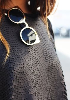 matte black sequins and karen walker shades