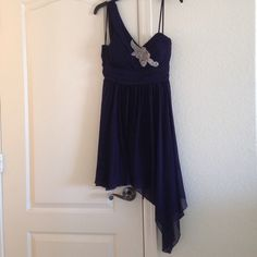 Navy Formal Dress Very pretty navy color. Asymmetrical hem. Chiffon. One shoulder. Fits at or right above depending on height. Dresses