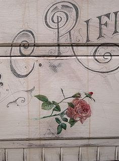 close up detail of rose image on previous dresser post