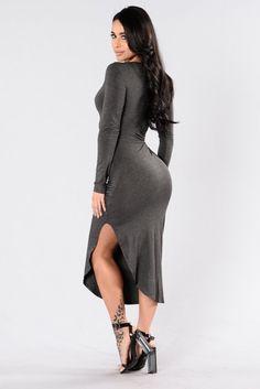 - Available in Charcoal and Burgundy - Long Sleeve Dress - Deep V Neckline - Cinched Waist - Overlap Bottom - Asymmetrical Bottom - 95% Rayon 5% Spandex
