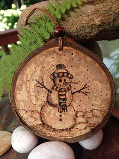 Snowman pyrography wood burned ornament created by Sandy Blanc for sale on Etsy.