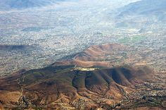 the ruins of Monte Alban (on the hill top) with the city of Oaxaca sprawling below by quercus design