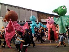 Large Puppets   Simple shapes, poles for arms, fabric for body.  Good inspiration!