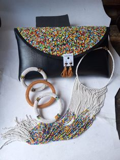 This beautiful purse comes with matching accessories for that trendy look. Beaded Clutch, Beaded Purses, Beaded Earrings, Beaded Bracelets, Bangles, Brown Clutch Bags, Leather Clutch Bags, Perfect Gift For Her, Casual Bags