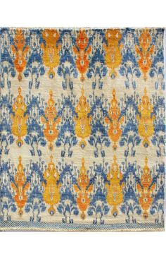 love this rug for the dowstairs room! Ikat rug in blue and yellow  Perfect!