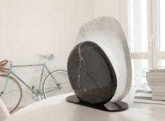 the idea sparked a dialogue between the marble and stone craftsmanship of the…