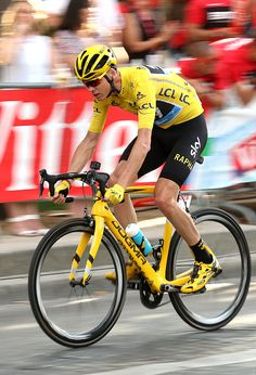 Chris Froome of Great Britain and Team Sky wearing the leader's yellow jersey rides among the pack during stage 21 last stage of the Tour de…