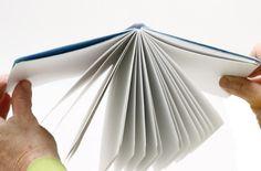 Double fan binding instructions; durable adhesive binding lays flat