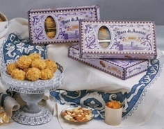 BACI DI ASSISI - It's a delicious pastry of soft almond paste with pistachio taste, rolled on a bed of almonds cut in thin leaves. Serve with Moscato wine.
