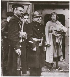 A Belgian girl convicted of Treason, being led to her execution by firing squad.