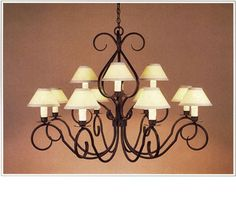 "7070-48  TWELVE LIGHT TWO TIER IRON CHANDELIER FINISH SHOWN: PUEBLO SHADE: 3X8X5 WITH WHITE WAX CANDLES MAXIMUM WATTAGE: 720 CANDELABRA BASE SOCKETS HT 36"" W 48"""