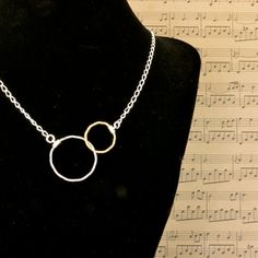 Unity Guitar String Necklace by High Strung Studios. Electric and Acoustic strings together represent harmony, unity, love. Makes a great statement. Very popular two-tone look! $38