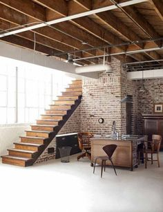 An exposed brick wall has become a popular feature in interior design. Leaving a wall bare with the bricks visible can give an apartment, home or loft an industrial and unconventional touch and adds c Loft Studio, Garage Studio, Dream Studio, Industrial Loft, Industrial Interiors, Industrial Design, Industrial Furniture, Industrial Decorating, Rustic Loft