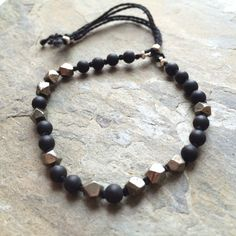 Subtle, matte onyx and pyrite stone bracelet, carefully hand knotted with black thread. Perfectly unisex, casual bracelet.