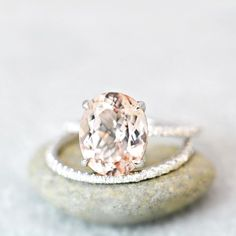 **love this - but probably with a diamond center stone. like the morganite because it's light pink but only if it's like stunning and perfect. Oval Cut Morganite & Diamond Engagement by AnyeJewelry Accesorios Casual, Gold Engagement Rings, Wedding Engagement, Unique Engagement Rings Simple, Pink Engagement Rings, Surprise Engagement, Perfect Engagement Ring, Engagement Ring Settings, Bridal Rings