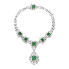 Platinum, 18 Karat Gold, Emerald and Diamond Necklace, Greenleaf & Crosby The graduated necklace supporting a pear-shaped pendant, set with seven emerald-cut emeralds weighing approximately 39.70 carats, set with five marquise-shaped diamonds weighing 5.28 carats and one pear-shaped diamond weighing 1.34 carats, further set with numerous round, pear and marquise-shaped diamonds weighing approximately 79.00 carats, length 14¾ inches, separates into three sections measuring 6½, 4½ and 3¾…