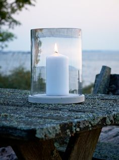 Möja candle lantern. Clear glass with a concrete plate. Design: Martin dos Santos. Photo: Johan Carlson