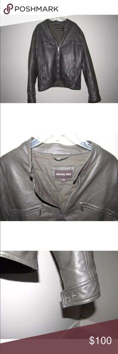 Michael Kors Gray Faux Leather Biker Jacket Size L Michael Kors Mens Gray Faux Leather  Biker Jacket Size Large, Two Inside Pockets, Four Outside Pockets, In Excellent Like - New Condition, Clean And Ready To Wear From Smoke Free Home!  Shell: %100 Polyurethane With %100 Viscose Back  Body Lining: %65 Polyester %35 Cotton  Sleeve Lining & Pocketing : %100 Polyester  Insulation: %100 Polyester  Will Consider Reasonable Offers!  Any Question? Please Ask! Feel Free To Check Out My Other Items…