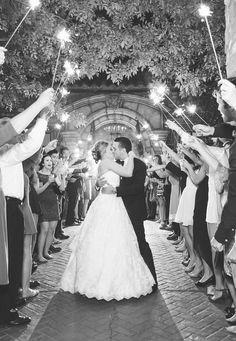 Couple share the traditional sparkler send off outside the Villa Siena front entrance | Monique Hessler Photography | villasiena.cc