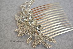 This is a gorgeous rhinestone embellished hair comb perfect for that special day. Wear it by itself in your hair or can be used as a veil