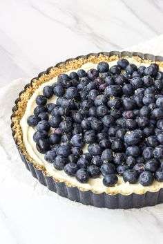 Blueberry white chocolate tart uses luscious mascarpone cheese and an almond crust for a dessert that's easy to make ahead.