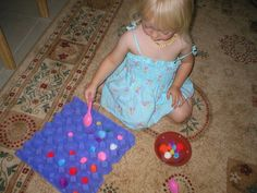 Pompoms and an eggbox