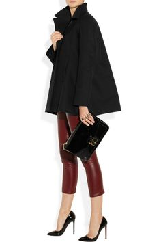The Row coat, top and pants, Maison Martin Margiela rings, Christian Louboutin shoes, Marc Jacobs bag.