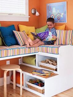 Comfy reading nook with built-in storage and doubles as a work surface.  DIY instructions included. Could work as bed with some railings added.
