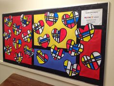 This art activity was inspired by Mrs. T's First Grade Class. Our version was done a bit differently. We drew lines on heart templates with pencils and rulers and then painted in our shapes. When