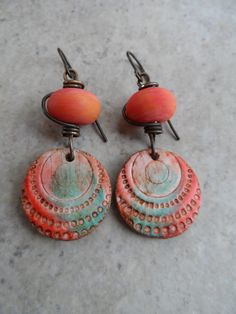 Gorgeous primitive polymer clay charms, expertly handcrafted by Asia at Winter Bird Studio, are perfectly paired together with amazing apricot coral