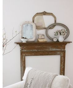 rustic arrangement of mirrors and empty frame