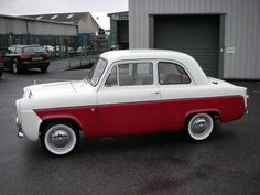 """1958 FORD ANGLIA 100E DELUXE 2-Door  (1958) Mine was powder blue with white tucked & rolled upholstery. Looked beautiful, but a mechanical disaster. Threw a rod through block and gave it to a friend just to end my """"money drain"""" nightmares. My father warned me, """"Never buy a vehicle based on looks alone. It's the mechanics of any thing that are most important. But, you always have to learn the hard way."""" My dad knew me well. After this fiasco, I realized how smart, wise and correct he was."""