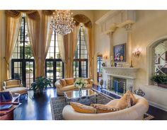 gorgeous high ceilings, chandelier, and enormous windows